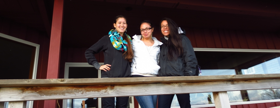 AIS students Victoria Plumage, Alana Quintasket, and Acacia Huff on a field trip to Suquamish