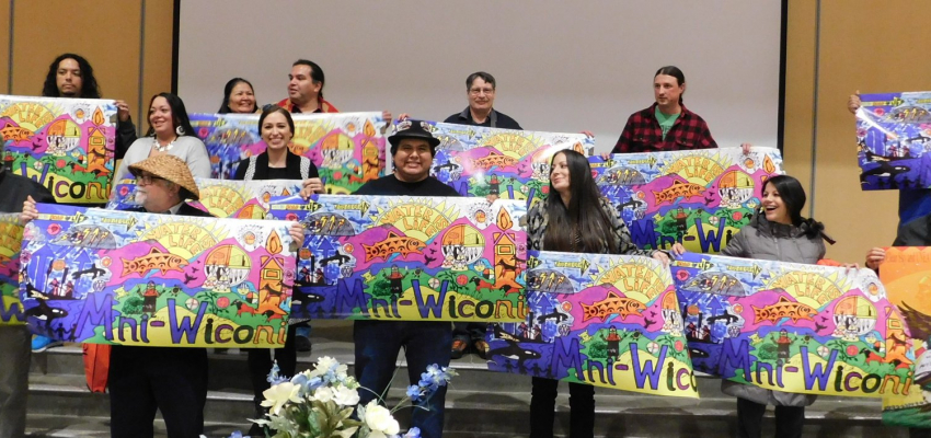 Students holding banners at the Clear Sky 10 year celebration