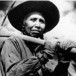 Plasi Cocowee, a memer of the Salish Tribe, works on Kerr Dam at the height of its construction in 1937.