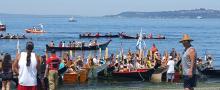 Canoes landing on Alki Beach during the Tribal Canoe Journeys, July 2018
