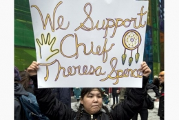Woman with sign supporting chief Teresa Spence
