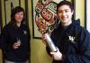 AIS majors Stephanie Riedl and Damon Cunningham with AIS gear