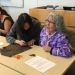 Elizabeth Fleagle, right, leads a beading workshop as one of UW's Elders in residence. Photo by Jordan Lewis