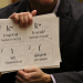 Chris Teuton, chair of American Indian Studies at the UW, displays the next letter for the group to practice. Teuton is Cherokee. (Alan Berner/The Seattle Times)